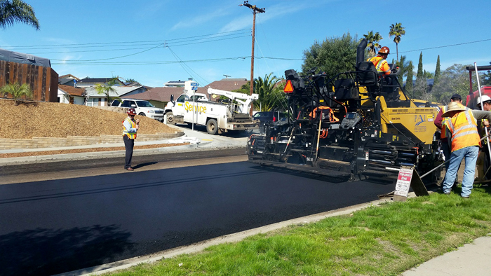 Asphalt equipment utlized to improve Floyd Street